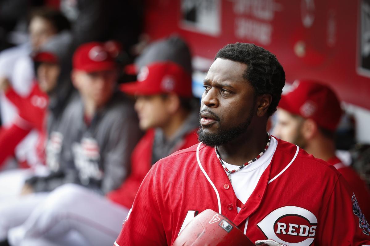 cc704bb8300 Cincinnati Reds second baseman Brandon Phillips walks through the dugout in  the sixth inning of a