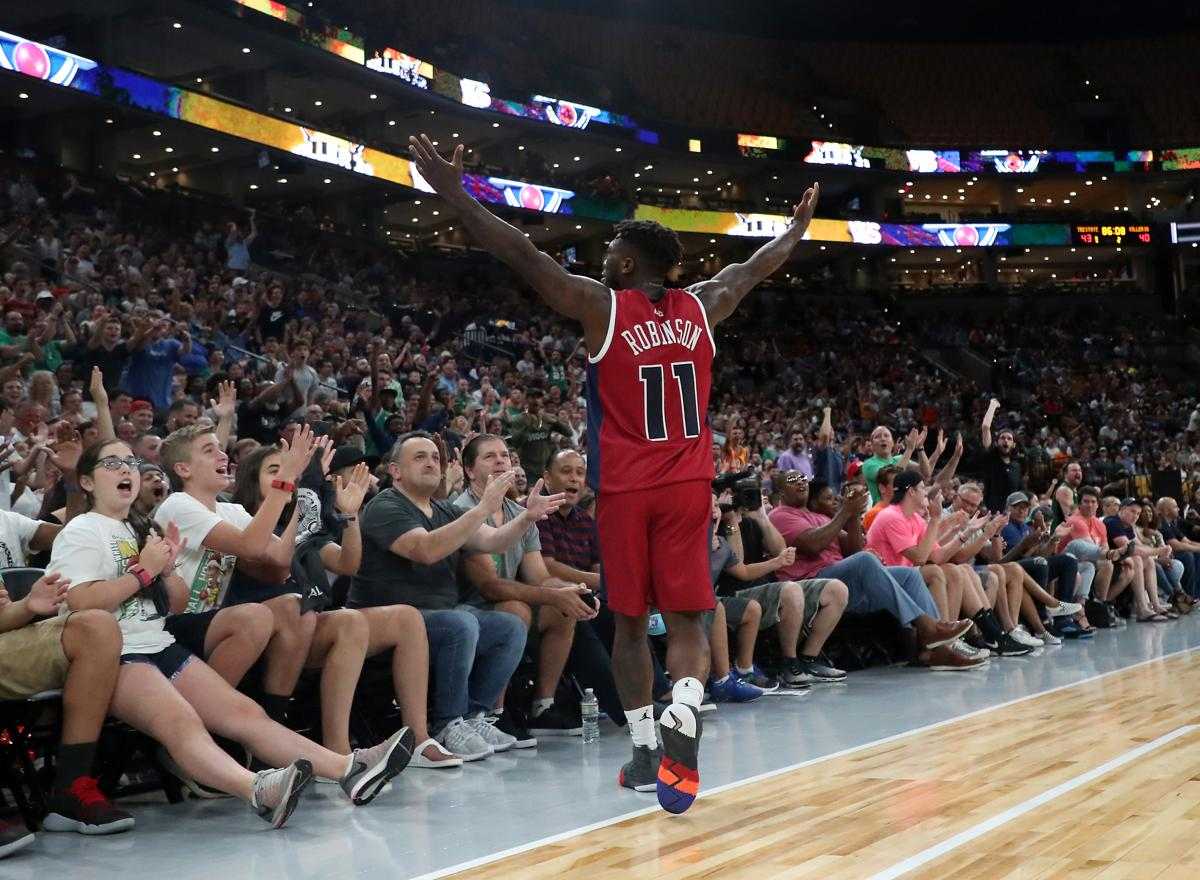 Former Celtic Nate Robinson, now of Tri State in the Big3, celebrates with the fans after they defeated the Killer 3s at TD Garden.