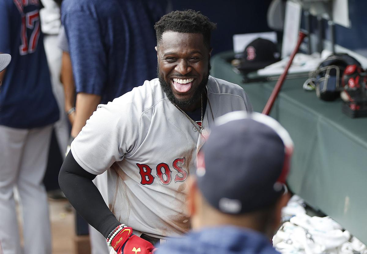 0ad8437204f Boston Red Sox Brandon Phillips celebrates in the dugout after hitting a  two-run home