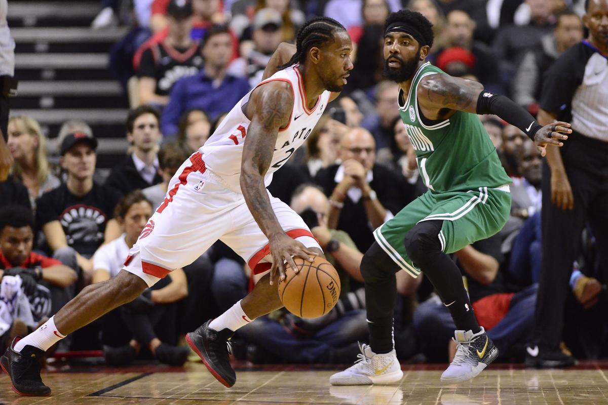 Toronto Raptors forward Kawhi Leonard (2) moves upcourt as Boston Celtics  guard Kyrie Irving cb1ad99393