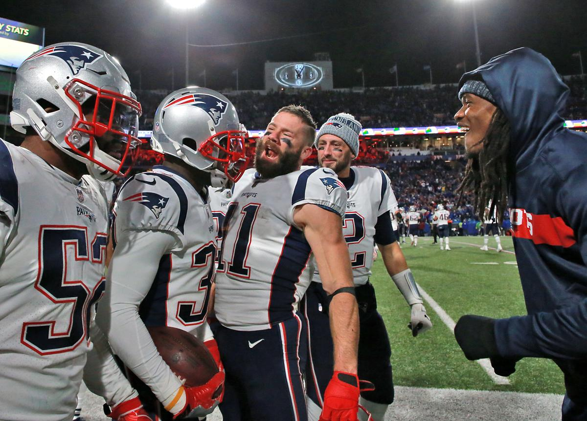 Devin McCourty (second from left) is greeted by his teammates after his 84- e75079fa1