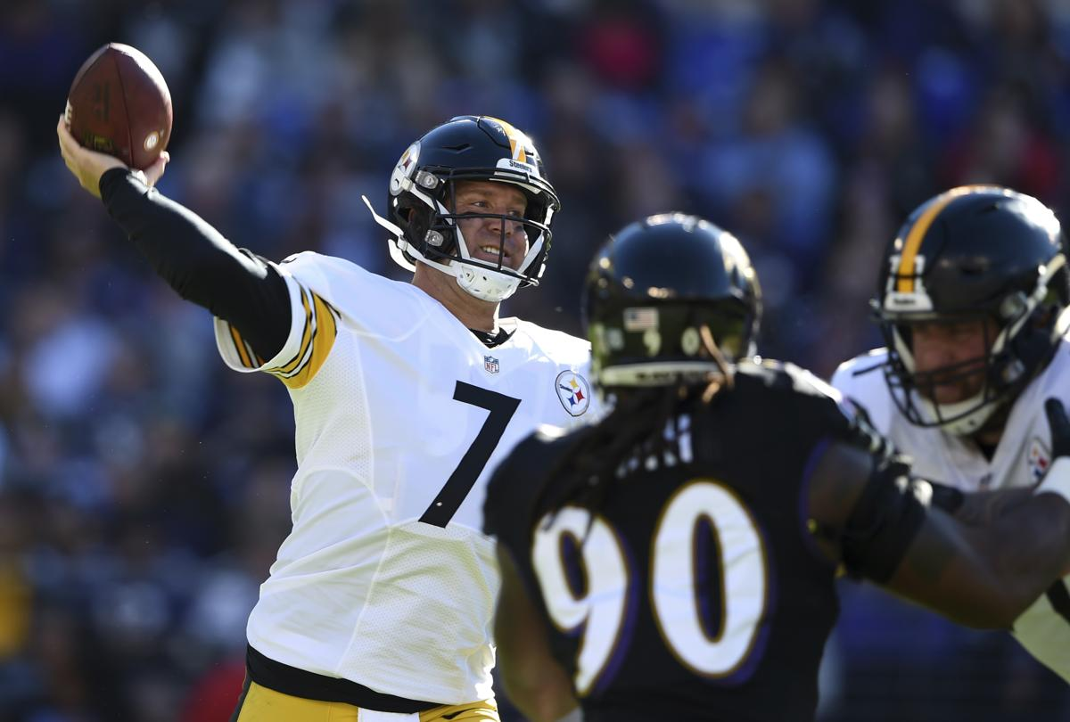 Pittsburgh Steelers Quarterback Ben Roethlisberger Left Throws To A Receiver As He Is Pressured