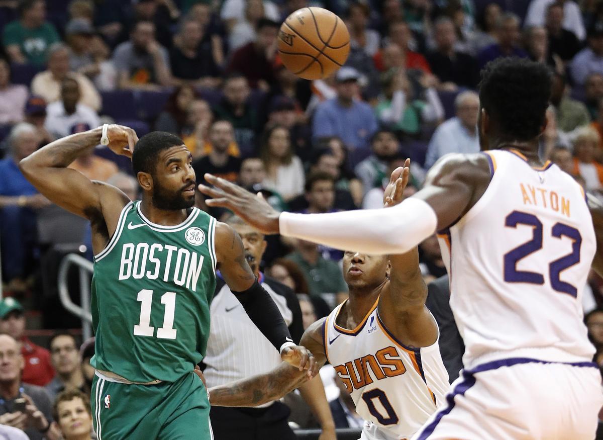 2b569b826afb Boston Celtics guard Kyrie Irving (11) throws a pass over Phoenix Suns  guard Isaiah