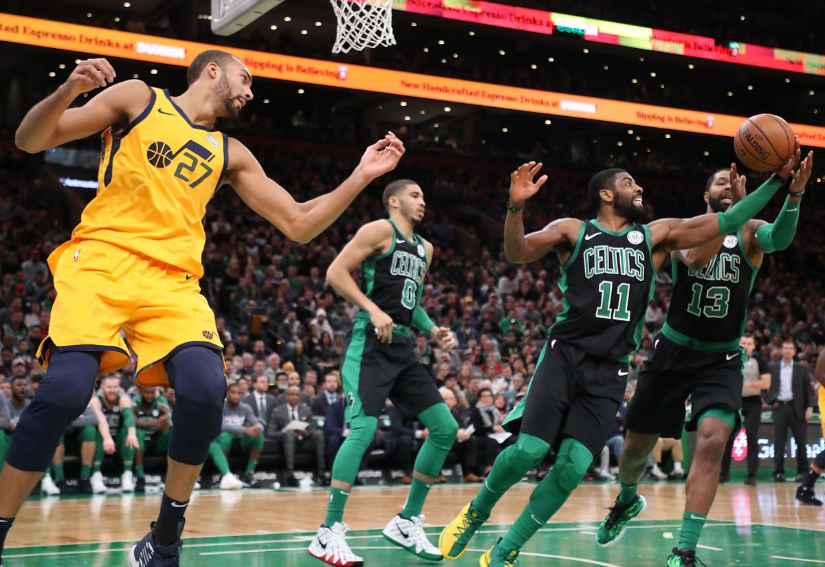 Boston MA 111718 Boston Celtics Kyrie Irving and Marcus Morris battle for