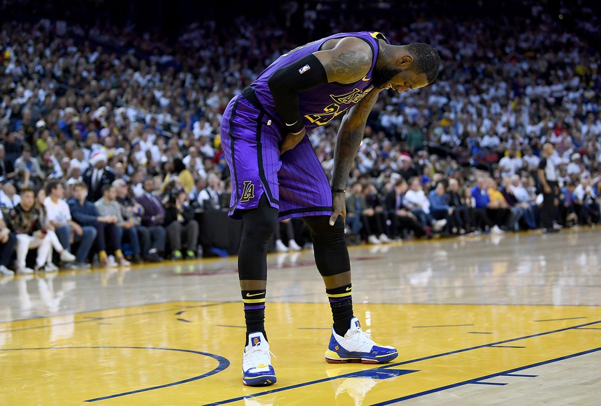 NBA Christmas Roundup  LeBron James injured in Lakers  rout of Warriors eeca5fdce526