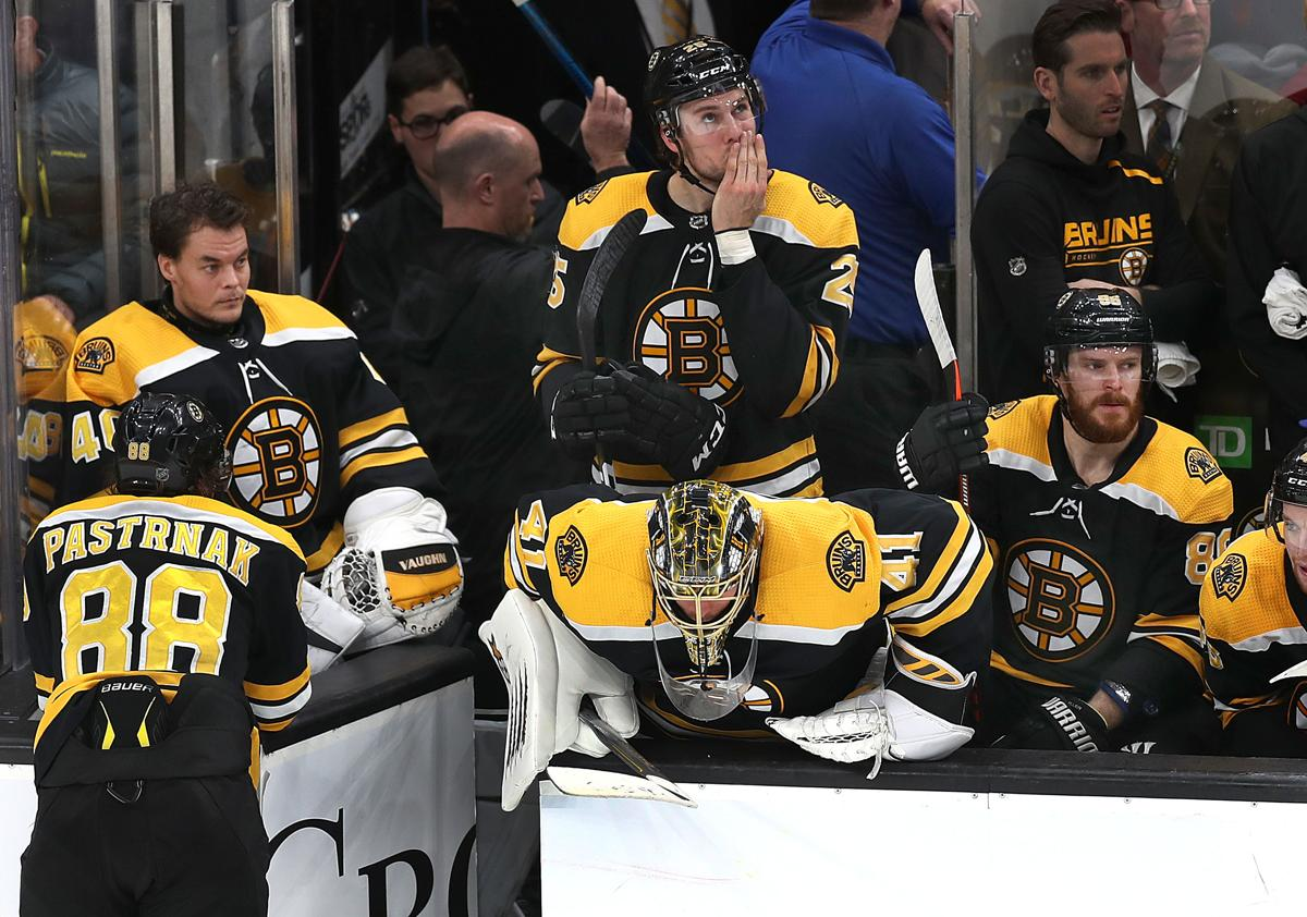 94ee7f7ff6c Bruins goalie Jaroslav Halak bows his head on the bench after he was pulled  late in