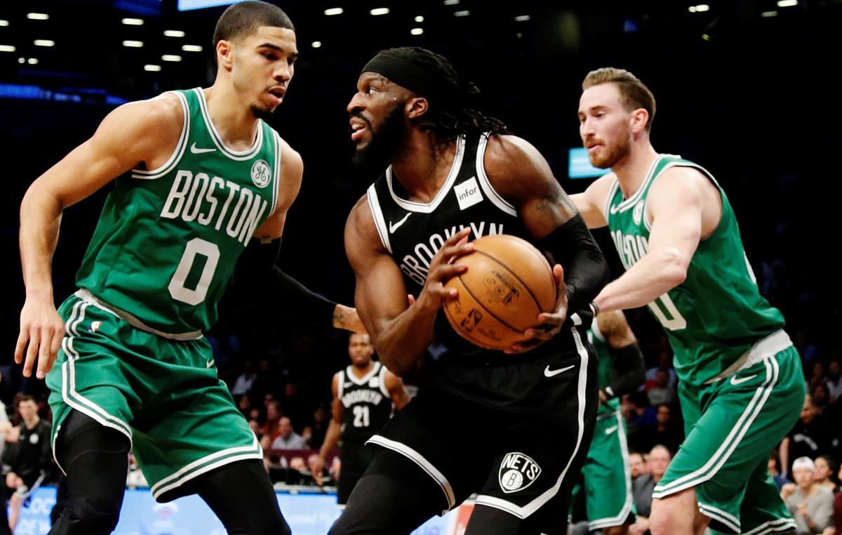 Brooklyn Nets  DeMarre Carroll (9) is defended by Boston Celtics  Jayson  Tatum ae2ed8e57