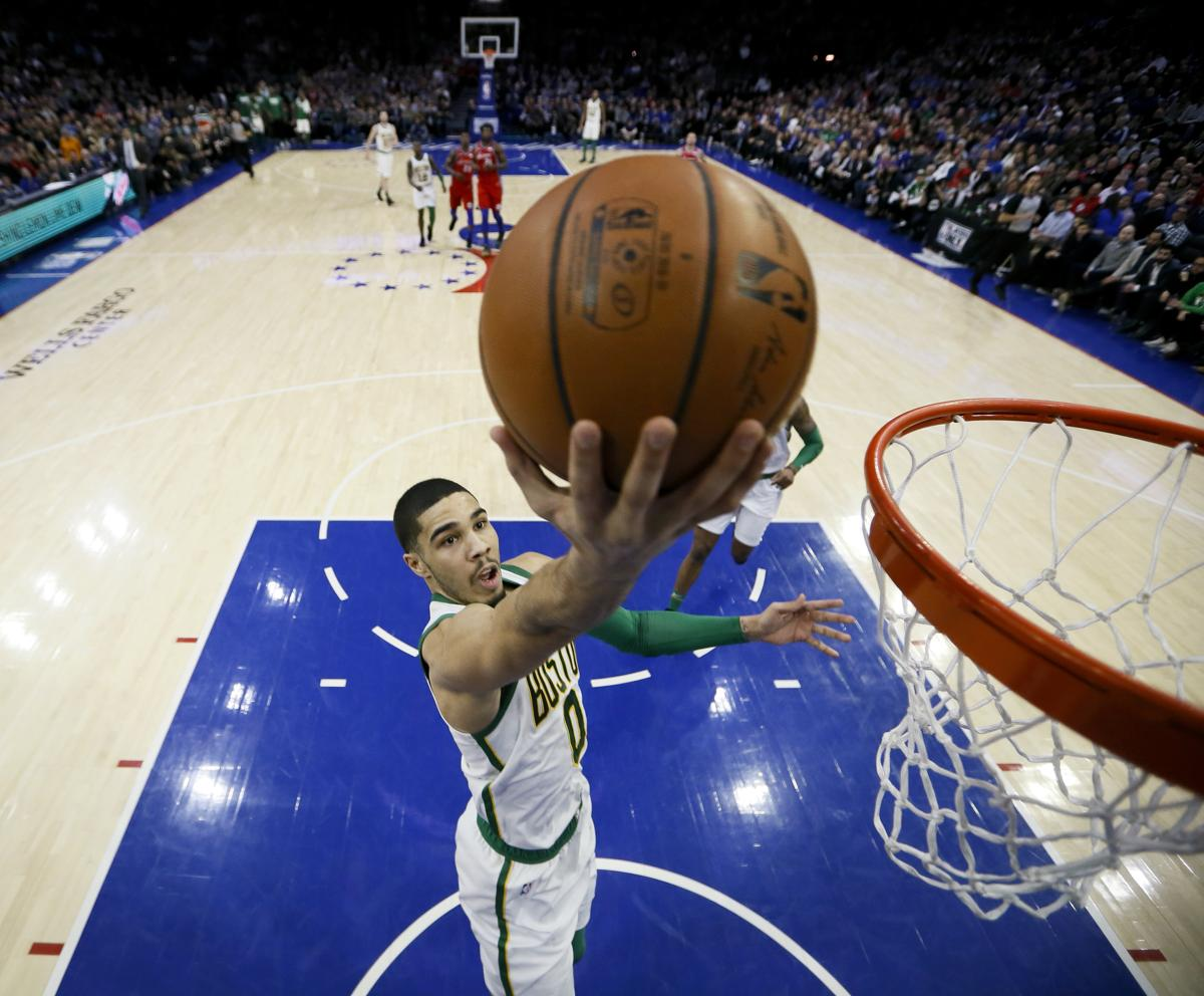 90e1f1e570a Boston Celtics  Jayson Tatum goes up for a shot during the first half of an
