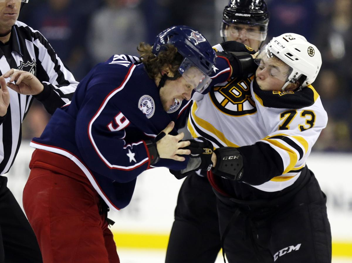 c8f6bb42c Columbus Blue Jackets forward Artemi Panarin, left, of Russia, and Boston  Bruins defenseman