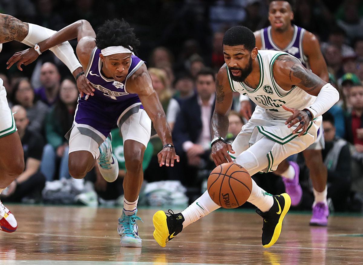 Boston-03 14 19 Bostn Celtics vs Kings -Celtics Kyrie Irving gets e43c87f8b000