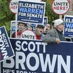Supporters Scott Brown and Elizabeth Warren held signs prior to a debate in Lowell on Oct. 1.