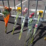Flowers lay against a barricade near the finish line of the Boston Marathon and the site of deadly twin bombings.