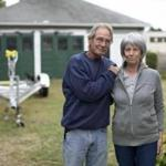 David and Beth Henneberry, with the trailer for their new boat, in Watertown.