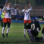 Watertown's Emily Loprete (9) and Alexandra Doggett (2) had reason to celebrate, including a state title.