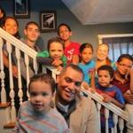 Martin Ervin has a business making hot sauces under the brand name 9 Lazy Kidz. He is holding his son Chance. On the stairs of their Hull home are (from top of stairs) Aisha, Tiara, Ramon, Quintin, Martin Jr. (in red), Skye (in light blue), wife Michelle, Malik, and Miles.
