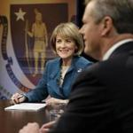 Martha Coakley and Charlie Baker met in a debate in Boston a week before the election.