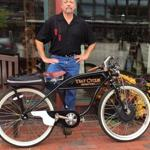 Stewart Shernan with one of the electric hybrid bicycles he has built.