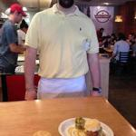 Gus Evans, co-owner of Maple Street Biscuit Company, with a couple of biscuit dishes.