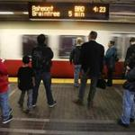 Boston, MA 12/22/2015 – Commuters wait for a Red Line train at the Park Street T Station in Boston, MA December 22, 2015. (Globe staff photo / Craig F. Walker) MBTA