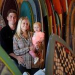 Owners Daniel and Jess Hassett and their daughter, Faye, 1, pose for a portrait at Levitate in Marshfield. (Craig F. Walker/Globe Staff)