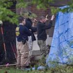 FBI officials paused for a discussion as they searched the home of gangster Robert Gentile in Manchester, Conn., Monday.