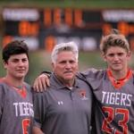 NEWTON, MA - 05/17/16 - West high school lacrosse feature on Newton North coach Bussy Adam, and his sons, Bryce Adam (23) and Hunter Adam (6), both players on the Tigers. Lane Turner/Globe Staff Section: SPORTS Reporter: Mike McMahon Slug: 22weblax
