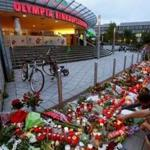 A memorial grew on Saturday outside the Olympia shopping mall, where the shooting rampage on Friday began. Most of the dead were youths and all were Munich residents.