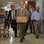 William Weld delivered petitions to the secretary of state's office Monday to put the Libertarian Party on the Massachusetts ballot. Weld, a former governor, is running for vice president on the ticket.
