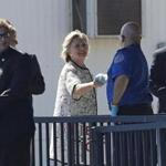 Democratic presidential candidate Hillary Clinton greets people as she arrives at Provincetown Municipal Airport in Provincetown, Mass., Sunday, Aug. 21, 2016. Clinton is traveling to a fundraiser at the Pilgrim Monument and Provincetown Museum in Provincetown. (AP Photo/Carolyn Kaster)