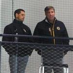 Boston-09/24/2016- The Bruins held another day of workouts at their training camp at Warrior Ice Arena. Bruins general manager Don Sweeney(left) chats with Bruins president Cam Neely as they watch the camp from the stands. Boston Globe staff photo by John Tlumacki(sports)