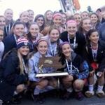 The Watertown High School field hockey team posed with the Division 2 title trophy.