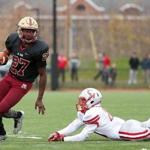 Boston MA 11/24/16 Boston College High Danny Abraham runs past Catholic Memorial James Moccio during third quarter action of thier Thanksgiving Day football game at Boston College High. (Photo by Matthew J. Lee/Globe staff) topic: 25bchigh reporter: