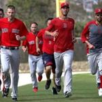Fort Myers, FL - 2/14/2017 - Boston Red Sox pitchers Chris Sale, Rick Porcello, and David Price end their workout with a run. Red Sox Spring Training. Day Two. Pitchers and catchers first workout at Jet Blue Park in Fort Myers, FL. - (Barry Chin/Globe Staff), Section: Sports, Reporter: Peter Abraham, Topic: 14Res Sox, LOID: 8.3.1634172896.