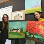 Amanda Abbott (left) and Leonie Little-Lex are among a group of local artists who sold more than $4,000 of watercolors, ceramics, prints, and jewelry to benefit Greater Boston Legal Services and the Refugee & Immigrant Assistance Center.