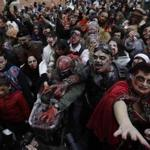 Zombies rally the streets during the Venice Carnival, in Venice, Italy, Saturday, Feb.11, 2017. The Venice carnival in the historical lagoon city attracts people from around the world. (AP Photo/Luca Bruno)