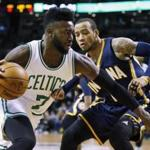 Boston Celtics' Jaylen Brown (7) drives past Indiana Pacers' Monta Ellis during the first quarter of an NBA basketball game in Boston, Wednesday, March 22, 2017. (AP Photo/Michael Dwyer)