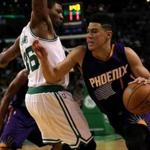 Suns guard Devin Booker drove on Celtics guard Marcus Smart in the first quarter.