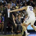 Connecticut head coach Geno Auriemma shouts instructions as Connecticut's Saniya Chong (12) defends against Oregon during the first half of a regional final game in the NCAA women's college basketball tournament, Monday, March 27, 2017, in Bridgeport, Conn. (AP Photo/Jessica Hill)