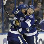 Tampa Bay Lightning defenseman Anton Stralman celebrates with left wing Ondrej Palat (18) after Stralman scored against the Chicago Blackhawks during the second period of an NHL hockey game Monday, March 27, 2017, in Tampa, Fla. (AP Photo/Chris O'Meara)