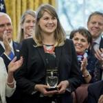 President Donald Trump, right, accompanied by Vice President Mike Pence, second from left, and his wife Karen, left, applauded after recognizing 2017 National Teacher of the Year award to Codman Academy 9th grade humanities teacher Sydney Chaffee.