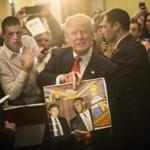 FILE - In this Jan. 29, 2016, file photo, Republican presidential candidate Donald Trump holds depictions of himself on,
