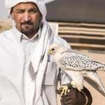 A falconer in the desert near Riyadh.