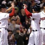 Boston, MA - 5/24/2017 - (7th inning) Boston Red Sox second baseman Josh Rutledge (32) and Boston Red Sox right fielder Mookie Betts (50) celebrate at the plate after scoring on a 2 RBI single by Boston Red Sox second baseman Dustin Pedroia (15), not pictured, during the seventh inning. and The Boston Red Sox host the Texas Rangers in the second of a three game series at Fenway Park. - (Barry Chin/Globe Staff), Section: Sports, Reporter: Peter Abraham, Topic: 25Sox-Rangers, LOID: 8.3.2576713733.