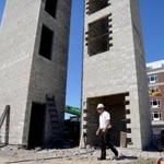 Quincy 06/15/2017: Developer Scott Galvin of Galvin Contruction , walks past the elevator and stairs of the second condo building that is being built with the finished condo behind him, at the site of the new residential Cliveden Place in Quincy. His partner and brother Sean said that they would not have made the investment in the building of the new condos if the city was not making the investments in infrastructure improvements.The city of Quincy is planning to spend $80 million in tax revenue on infrastruction improvements to inhance its growing downtown including $46 million on a new parking garage . Photo by Debee Tlumacki for the Boston Globe (south)