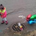 "Children at Halloween near the drain haunted by Pennywise, the evil clown of Stephen King's ""It."""