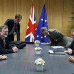 British Prime Minister Theresa May attendeds a meeting with European Council president Donald Tusk (right) during a European Union leaders summit in Brussels Thursday.