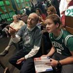 Boston Celtics fans William Goodman, left, and his son Eli, of Hollis, N.H., watch during the team's NBA basketball draft party at TD Garden, Thursday, June 22, 2017, in Boston. The Celtics chose Jayson Tatum in the first round. (AP Photo/Elise Amendola)