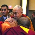 The Dalai Lama greeted and blesseed Tibetan monks before speaking to a crowd at the Sheraton Boston.