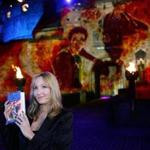 (FILES) This file photo taken on July 15, 2005 shows author J.K Rowling in front of Edinburgh Castle for the worldwide launch of the latest book, Harry Potter and the Half-Blood Prince. The creator of a wizarding empire which has dazzled the world, J. K. Rowling struggled through hardship to become an unrivalled children's author with a global voice. Now 20 years since