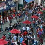 Boston, MA: August 3, 2017: Yawkey Way was crowded with fans and activity before the game at Fenway Park. FOR USE WITH INTERN'S